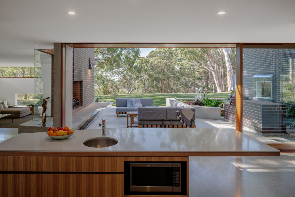 image looking from a kitchen to an outdoor living area