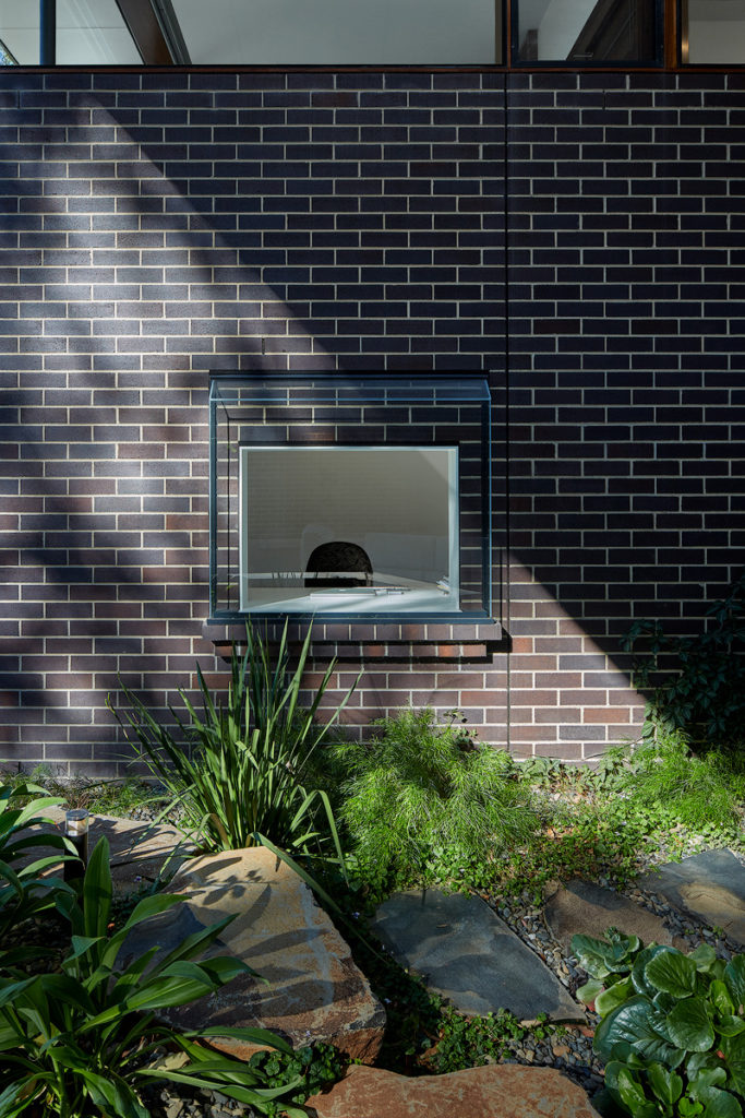Image of a unique window in a brick wall.