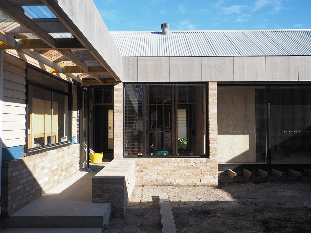 Photo Of A House Under Construction With A Brick Plinth In An Entry Walkway