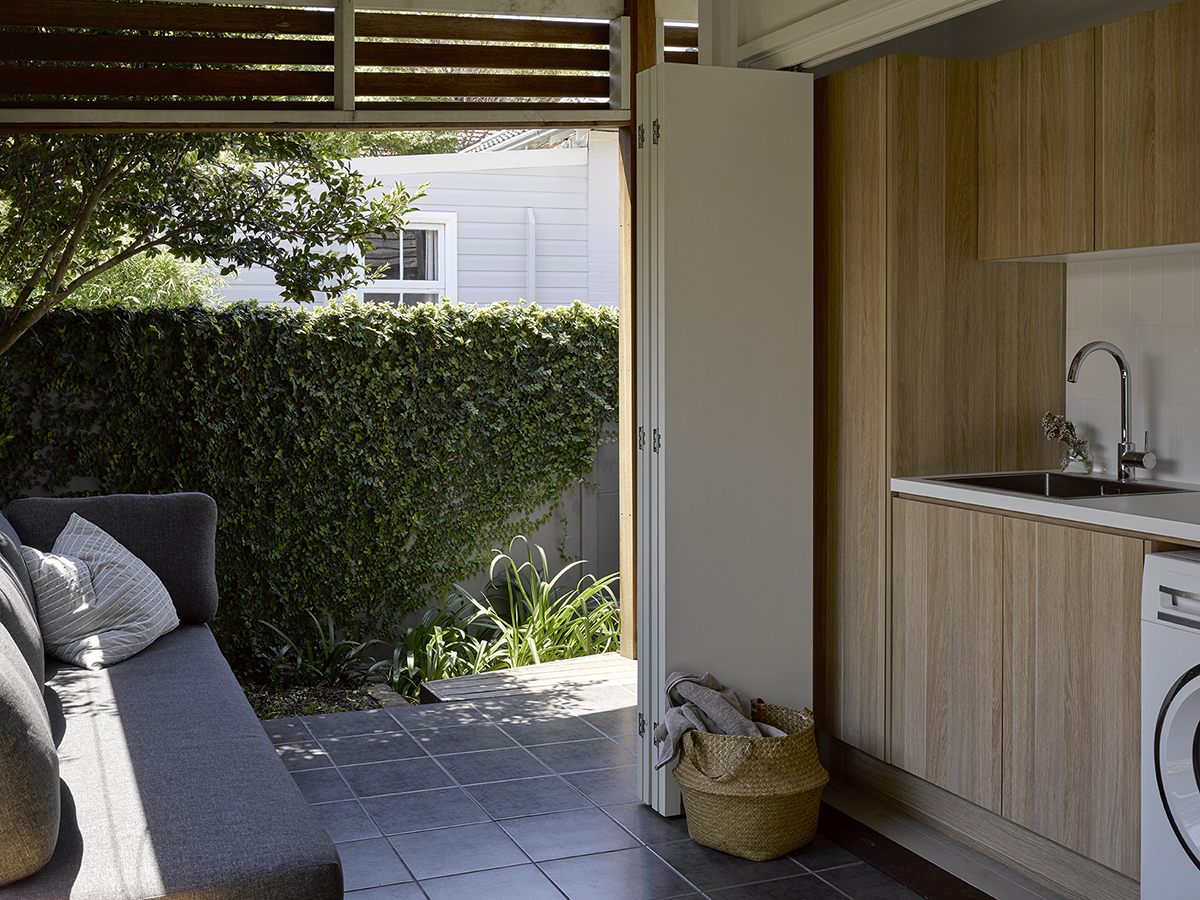 Image Of A Laundry Opening Onto A Covered Verandah With An Outdoor Sofa
