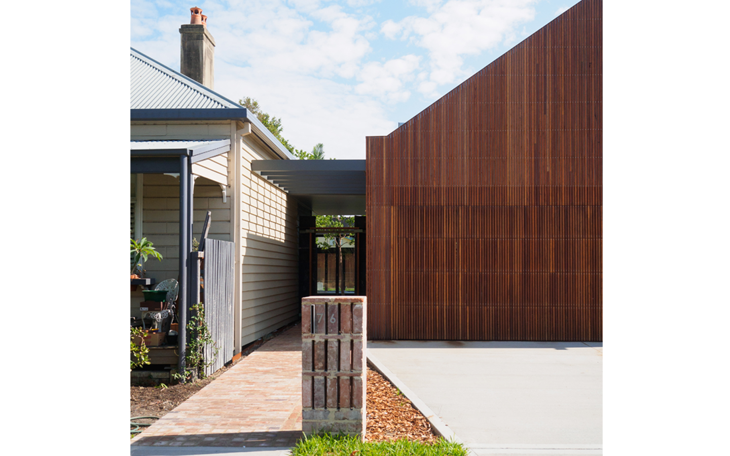 Image Of The Entry To A Home With Address Located At The Interface Of The Existing Building And. The New Alterations.